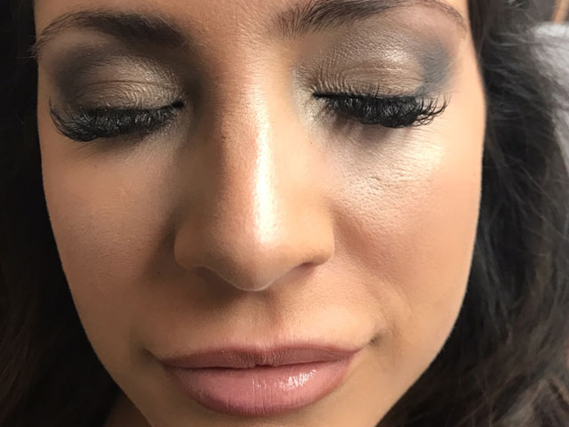Makeup on woman with short brown hair and eyes closed