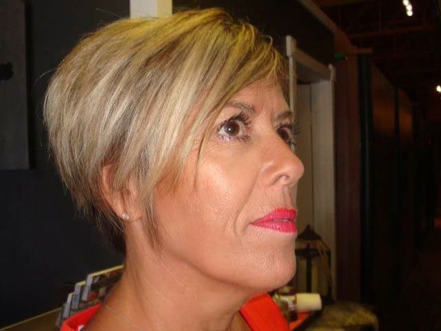 Makeup on mature woman with short blond hair and pink lipstick, profile view